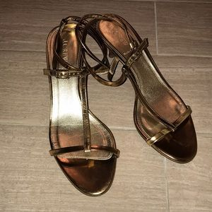 Rose gold strappy heels.
